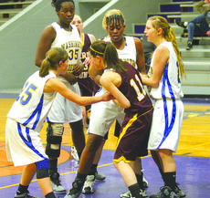 """<div class=""""source"""">Photo by Shorty Lassiter</div><div class=""""image-desc"""">The Commanderettes surrounded a Barren County player last Saturday, as they tried to force a turnover.</div><div class=""""buy-pic""""><a href=""""http://web2.lcni5.com/cgi-bin/c2newbuyphoto.cgi?pub=023&orig=-Lex%2BKenya%2BJP%2BNic.jpg"""" target=""""_new"""">Buy this photo</a></div>"""