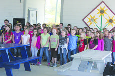"""<div class=""""source"""">Photo by Brandon Mattingly</div><div class=""""image-desc"""">Third-graders from NWES performed a poem and a song for the Earth Day celebration on Monday at the Washington County Farmer's Market.</div><div class=""""buy-pic""""><a href=""""/photo_select/14193"""">Buy this photo</a></div>"""