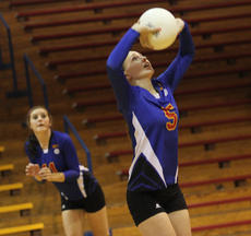 """<div class=""""source"""">John Overby</div><div class=""""image-desc"""">Junior Bethany Wheatley performs a textbook set for one of her teammates. It wasn't enough, however, as WC fell to the Jaguars in five sets.</div><div class=""""buy-pic""""><a href=""""http://web2.lcni5.com/cgi-bin/c2newbuyphoto.cgi?pub=023&orig=01_img_8619.jpg"""" target=""""_new"""">Buy this photo</a></div>"""