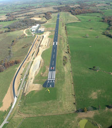 """<div class=""""source"""">Photo submitted</div><div class=""""image-desc"""">An aerial look at the airport.</div><div class=""""buy-pic""""></div>"""