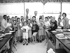 "<div class=""source"">Photo submitted</div><div class=""image-desc"">Springfield Rotarians David Foster and Craig Arnold (center) are pictured with St. Dominic's 4th grade class.  Each year the Springfield Rotary Club gives a dictionary to all fourth graders and a thesaurus to all fifth graders in Washington County schools. Ms. Ellery (left) is the reading arts teacher and Pam Breunig (right) is the principal of St. Dominic's. </div><div class=""buy-pic""></div>"