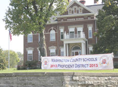 """<div class=""""source"""">Photo by Brandon Mattingly</div><div class=""""image-desc"""">Washington County School District earned a proficient rating with test score results from the 2012-13 school year. North Washington Middle (distinguished) and Washington County High School (proficient) were among the schools to take the biggest steps forward last year.</div><div class=""""buy-pic""""><a href=""""http://web2.lcni5.com/cgi-bin/c2newbuyphoto.cgi?pub=023&orig=10-16_test_scores_pic-front.jpg"""" target=""""_new"""">Buy this photo</a></div>"""