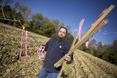 """<div class=""""source"""">Photo by Forrest Berkshire/The Kentucky Standard</div><div class=""""image-desc"""">Bill Allen of Bloomfield stands in his cornfield holding stakes he found while harvesting the crop. Allen said he has explicitly told Bluegrass Pipeline representatives to stay off his land. At least one of the stakes had Bluegrass Pipeline written on it.</div><div class=""""buy-pic""""><a href=""""/photo_select/15237"""">Buy this photo</a></div>"""