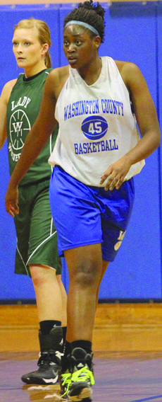 """<div class=""""source"""">Photo by Shorty Lassiter</div><div class=""""image-desc"""">Senior Jennifer Keene walks down the court on a change of possession.</div><div class=""""buy-pic""""><a href=""""/photo_select/15412"""">Buy this photo</a></div>"""
