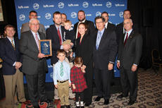 """<div class=""""source"""">Photo courtesy of Kentucky Farm Bureau</div><div class=""""image-desc"""">Shane and Mary Courtney (center) received the 2013 Outstanding Young Farm Family award during Kentucky Farm Bureau's annual meeting in Louisville. Presenting the award is Mark Haney, KFB President (left of Shane Courtney) and David S. Beck, KFB Executive Vice President (right of Mary Courtney) and the contest's award sponsors.</div><div class=""""buy-pic""""></div>"""