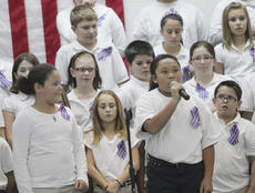 "<div class=""source"">Photo by John Overby</div><div class=""image-desc"">Keyava Trigg, left, and Cateline Hayden introduced the next song during Thursday's Veterans Day celebration at Washington County Elementary School.</div><div class=""buy-pic""><a href=""/photo_select/15335"">Buy this photo</a></div>"