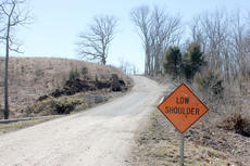 """<div class=""""source"""">Brandon Mattingly</div><div class=""""image-desc"""">Work began last Wednesday to accommodate a higher volume of traffic on the one-lane road, Spaulding Lane, near KY-555. Traveling the one-lane road had become a pain for local residents, officials say, and vehicles had difficulty passing on the narrow lane.   </div><div class=""""buy-pic""""><a href=""""/photo_select/13905"""">Buy this photo</a></div>"""