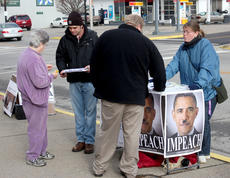 "<div class=""source"">Brandon Mattingly</div><div class=""image-desc"">Out-of-state activists, Alan Demers and Jenny Burns, represent the LaRouche PAC, an entity headed by political activist who wants to impeach President Barack Obama. The duo protested in downtown Springfield last Thursday and showcased posters of Obama with an Adolf Hitleresque mustache. </div><div class=""buy-pic""><a href=""/photo_select/13865"">Buy this photo</a></div>"