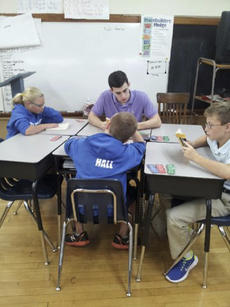 """<div class=""""source"""">Photo submitted</div><div class=""""image-desc"""">Sophomore Nick Porter joined several of his fellow SCC Patriots basketball teammates in the Patriot Pals' visit to St. Dominic recently. Students thoroughly enjoyed reading with the athletes.</div><div class=""""buy-pic""""></div>"""