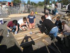 "<div class=""source"">courtesy of Josette Taylor</div><div class=""image-desc"">Josette Taylor and her fellow International Student Volunteers worked to construct a school, known as an educare center.</div><div class=""buy-pic""></div>"