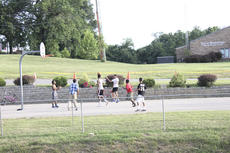 """<div class=""""source"""">Photo by Brandon Mattingly</div><div class=""""image-desc"""">A group of kids play basketball in front of the Springfield Police Department while the festival carries on.</div><div class=""""buy-pic""""><a href=""""/photo_select/16734"""">Buy this photo</a></div>"""