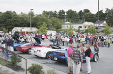 """<div class=""""source"""">Photo by Brandon Mattingly</div><div class=""""image-desc"""">Local residents gather around the Corvettes on display while waiting for the fieworks to begin.</div><div class=""""buy-pic""""><a href=""""/photo_select/16729"""">Buy this photo</a></div>"""