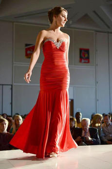 """<div class=""""source"""">Jacob Zimmer, Courtesy of The Courier-Journal</div><div class=""""image-desc"""">Sarah Cocanougher, 18, of Washington County, shows off her red evening gown at the Miss University of Louisville pageant last month. She won the evening gown competition and one of two crowns at the pageant, propelling her for a chance of winning the title of Miss Kentucky later this year.   </div><div class=""""buy-pic""""><a href=""""/photo_select/13954"""">Buy this photo</a></div>"""