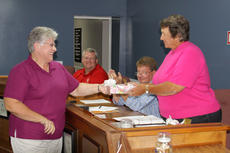 """<div class=""""source"""">G. Hamill </div><div class=""""image-desc"""">Board of Education chairman Patsy Lester presents a retirement gift to teacher Cathy Burns during the June 17 board meeting. </div><div class=""""buy-pic""""><a href=""""/photo_select/14538"""">Buy this photo</a></div>"""