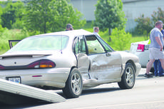 """<div class=""""source"""">Photo by Brandon Mattingly</div><div class=""""image-desc"""">Rebecca Bowman was driving this 1999 Pontiac Bonneville when she was involved in an accident last Tuesday.</div><div class=""""buy-pic""""><a href=""""http://web2.lcni5.com/cgi-bin/c2newbuyphoto.cgi?pub=023&orig=6-5_accident.jpg"""" target=""""_new"""">Buy this photo</a></div>"""