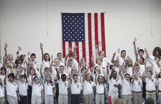 "<div class=""source"">Photo by John Overby</div><div class=""image-desc"">WCES students held their flags high at the end of Thursday's Veterans Day celebration.</div><div class=""buy-pic""><a href=""/photo_select/15334"">Buy this photo</a></div>"