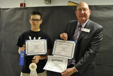 """<div class=""""source"""">Photo submitted</div><div class=""""image-desc"""">Steve Miller of U.S. Rep. Brett Guthrie's office presented WCHS sophomore Mac Stevens with certificates and ribbons for participation in the Congressional Art Competition and for third place in Guthrie's district.</div><div class=""""buy-pic""""></div>"""