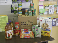 "<div class=""source"">Photo by Brandon Mattingly</div><div class=""image-desc"">Pictured above is the contents of a box provided by Feeding America.</div><div class=""buy-pic""><a href=""http://web2.lcni5.com/cgi-bin/c2newbuyphoto.cgi?pub=023&orig=9-18_comm._action8.jpg"" target=""_new"">Buy this photo</a></div>"