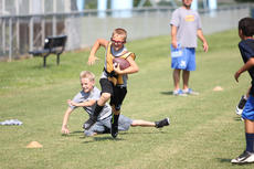 """<div class=""""source"""">Photo by Brandon Mattingly</div><div class=""""image-desc"""">The WCHS football team hosted a youth camp last week, and some of the local youngsters were able to show off their skills. Above - Beau Baker avoided the defense and sprinted down the sideline after making a catch.</div><div class=""""buy-pic""""><a href=""""/photo_select/14509"""">Buy this photo</a></div>"""