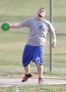 "<div class=""source"">Photo by Jeff Moreland</div><div class=""image-desc"">Senior Bradlee Lawson extends his arm to get maximum distance as he throws the discus.</div><div class=""buy-pic""><a href=""/photo_select/14131"">Buy this photo</a></div>"