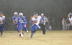"<div class=""source"">Photo by Brandon Mattingly</div><div class=""image-desc"">Junior quarterback Morgan Churchill scrambles for a first down as the rain poured down in Washington County's 49-7 loss.</div><div class=""buy-pic""><a href=""/photo_select/13179"">Buy this photo</a></div>"