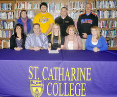 "<div class=""source"">Photo by SCC Sports Information</div><div class=""image-desc"">On hand for Southwestern High School senior Erin Cottrell's signing were, front row from left, Annette Dodson, Skip Cottrell, Erin Cottrell, Julie Shepperd and Whitley Chitwood; back row from left, Danita Ellis, Tyler Dodson, Jason McDannold and Scott Gregory.</div><div class=""buy-pic""></div>"
