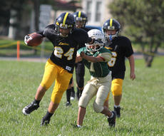 "<div class=""source"">Photo by Brandon Mattingly</div><div class=""image-desc"">Sunday marked the first day of the Blake Hoppes youth football season, with Springfield teams posting a 1-2 record on the day. Above, Devin Hurst frees himself for a breakaway touchdown run in the Springfield Steelers' (fifth-sixth grade) 25-0 win over Campbellsville. The third-fourth grade Springfield Colts lost to Marion County 27-7. The kindergarten-second grade Springfield Eagles fell to Cville, 25-20.</div><div class=""buy-pic""><a href=""/photo_select/12730"">Buy this photo</a></div>"