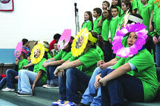 "<div class=""source"">Photo by Brandon Mattingly</div><div class=""image-desc"">Above, students dressed as flowers during an Earth Day presentation.</div><div class=""buy-pic""><a href=""/photo_select/14053"">Buy this photo</a></div>"