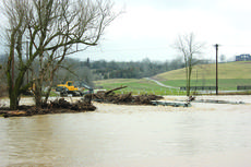 "<div class=""source"">Photo by Brandon Mattingly</div><div class=""image-desc"">The Grundy Home Road bridge was flooded by heavy rains last Monday prior to its re-opening (on Wednesday) from construction.</div><div class=""buy-pic""><a href=""/photo_select/14043"">Buy this photo</a></div>"