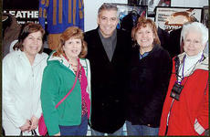 """<div class=""""source"""">Submitted</div><div class=""""image-desc"""">Four local ladies recently met movie star George Clooney. From left are Lisa Carrico, Amanda Mattingly, George Clooney, Debbie Collard and Teresa Mattingly.</div><div class=""""buy-pic""""></div>"""