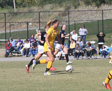 "<div class=""source"">Photo by SCC Sports Information</div><div class=""image-desc"">Sarah Herbert, a freshman from Sacred Heart Academy in Louisville, moves the ball downfield. Herbert had two goals and one assist in the 6-0 win over Berea College.</div><div class=""buy-pic""></div>"