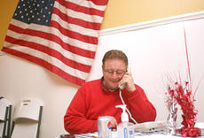 "<div class=""source"">Stephen Lega</div><div class=""image-desc"">Jimmy Higdon, the Republican candidate in the 14th District senate seat special election, works the phones to get out the vote in the final hours before the polls close Dec. 8.</div><div class=""buy-pic""><a href=""/photo_select/128"">Buy this photo</a></div>"