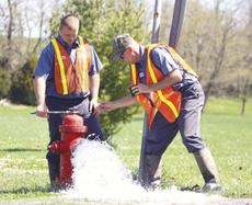 """<div class=""""source"""">Jeff Moreland</div><div class=""""image-desc"""">Brandon Bartley, left, and Danny """"Mo"""" Bishop of the Springfield Sewer and Water Commission, were busy flushing fire hydrants in downtown Springfield Thursday.</div><div class=""""buy-pic""""><a href=""""http://web2.lcni5.com/cgi-bin/c2newbuyphoto.cgi?pub=023&orig=Hydrant1.jpg"""" target=""""_new"""">Buy this photo</a></div>"""