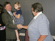 """<div class=""""source"""">Jeff Moreland</div><div class=""""image-desc"""">Rob Stafford, the new superintendent of Washington County Schools, shook hands with  board chair Patsy Lester after signing his contract Monday night. Stafford is holding his four-year-old daughter, Tylor. Stafford and his wife, Jennifer, are also expecti</div><div class=""""buy-pic""""><a href=""""/photo_select/4477"""">Buy this photo</a></div>"""