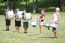 """<div class=""""source"""">Photo by Brandon Mattingly</div><div class=""""image-desc"""">Above, the drumline readied for the next drill as the Washington County High School marching band prepared for the upcoming season last week.</div><div class=""""buy-pic""""><a href=""""/photo_select/14717"""">Buy this photo</a></div>"""