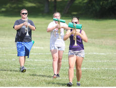 """<div class=""""source"""">Photo by Brandon Mattingly</div><div class=""""image-desc"""">Austin Coffey, Cassie Edwards and Emma Peavler led the way during a practice at the recent band camp.</div><div class=""""buy-pic""""><a href=""""/photo_select/14718"""">Buy this photo</a></div>"""