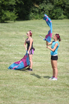 """<div class=""""source"""">Photo by Brandon Mattingly</div><div class=""""image-desc"""">Mickayla Hood and Anna Edelen of the WCHS color guard practiced during some down time.</div><div class=""""buy-pic""""><a href=""""/photo_select/14719"""">Buy this photo</a></div>"""
