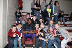 """<div class=""""source"""">Photo by SCC Sports Information</div><div class=""""image-desc"""">Following his stint with pro basketball, Ervin Williams plans to coach young athletes. He seems right at home here as a senior with his St. Catharine College team that visited St. Augustine Grade School in Lebanon.</div><div class=""""buy-pic""""></div>"""