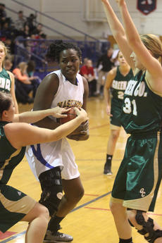 """<div class=""""source"""">Photo by Brandon Mattingly</div><div class=""""image-desc"""">Senior Kenya Turner fought a ball away from a Green County player in Monday night's 76-52 loss.</div><div class=""""buy-pic""""><a href=""""/photo_select/13698"""">Buy this photo</a></div>"""