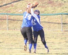 "<div class=""source"">Photo by Brandon Mattingly</div><div class=""image-desc"">Junior Maddie Abell made the catch in centerfield despite colliding with teammate Mary Beth Lawson.</div><div class=""buy-pic""><a href=""/photo_select/14063"">Buy this photo</a></div>"