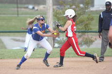 """<div class=""""source"""">Photo by Brandon Mattingly</div><div class=""""image-desc"""">Senior LeeAnn Abell slapped a tag on a Nelson County baserunner to start the game-ending double play in Monday's 11-1 win.</div><div class=""""buy-pic""""><a href=""""http://web2.lcni5.com/cgi-bin/c2newbuyphoto.cgi?pub=023&orig=IMG_7566.JPG"""" target=""""_new"""">Buy this photo</a></div>"""
