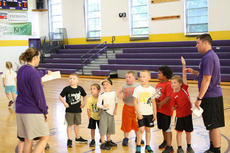"<div class=""source"">Photo by SCC Sports Information</div><div class=""image-desc"">St. Catharine Assistant Coach Tyler Campbell and Head Coach Lena Bramblett prepared campers for a drill at last week's St. Catharine College Basketball Camp.</div><div class=""buy-pic""></div>"