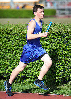 "<div class=""source"">Photo by Jeff Moreland</div><div class=""image-desc"">Dominic Murphy runs in a relay event at Marion County.</div><div class=""buy-pic""><a href=""http://web2.lcni5.com/cgi-bin/c2newbuyphoto.cgi?pub=023&orig=IMG_8225.jpg"" target=""_new"">Buy this photo</a></div>"