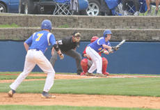 """<div class=""""source"""">Photo by Brandon Mattingly</div><div class=""""image-desc"""">Sophomore Wade Moore laid down a bunt to advance senior Thomas Spalding, foreground, to second base in Friday's 4-1 loss to Nelson County.</div><div class=""""buy-pic""""><a href=""""/photo_select/14221"""">Buy this photo</a></div>"""