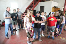 """<div class=""""source"""">Photo by Brandon Mattingly</div><div class=""""image-desc"""">Nathan Cochran showed a group of fifth-graders some of the equipment used when the fire department is called to an accident.</div><div class=""""buy-pic""""><a href=""""http://web2.lcni5.com/cgi-bin/c2newbuyphoto.cgi?pub=023&orig=IMG_8877.JPG"""" target=""""_new"""">Buy this photo</a></div>"""
