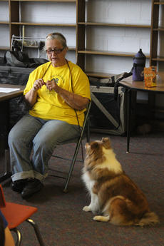"""<div class=""""source"""">Photo by Brandon Mattingly</div><div class=""""image-desc"""">Marley waited for his treat as Barbara Boylen talked to the students about animal safety.</div><div class=""""buy-pic""""><a href=""""http://web2.lcni5.com/cgi-bin/c2newbuyphoto.cgi?pub=023&orig=IMG_8891.JPG"""" target=""""_new"""">Buy this photo</a></div>"""