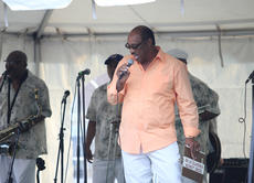 "<div class=""source"">Photo by Brandon Mattingly</div><div class=""image-desc"">Issac Frye joined The Jimmy Church Band for a song to kick off the show on Friday night at the African American Heritage Festival. Frye was just one of the special guests on stage that night.</div><div class=""buy-pic""><a href=""/photo_select/14705"">Buy this photo</a></div>"
