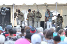 "<div class=""source"">Photo by Brandon Mattingly</div><div class=""image-desc"">The Jimmy Church Band put on a show Friday night at the African American Heritage Festival. The band was preceded by the youth talent show and led into the nightcap firework show, which were rescheduled from the postponed 4th of July festivities.</div><div class=""buy-pic""><a href=""/photo_select/14698"">Buy this photo</a></div>"