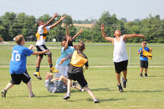 """<div class=""""source"""">Photo by Brandon Mattingly</div><div class=""""image-desc"""">Players on both sides went after a jump ball across the middle of the field.</div><div class=""""buy-pic""""><a href=""""/photo_select/14515"""">Buy this photo</a></div>"""