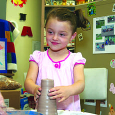 """<div class=""""source"""">Jeff Moreland</div><div class=""""image-desc"""">Isabella Murphy took her turn at working with clay on a potter's wheel at the public library summer reading kickoff last week.</div><div class=""""buy-pic""""><a href=""""http://web2.lcni5.com/cgi-bin/c2newbuyphoto.cgi?pub=023&orig=LibraryBelle.jpg"""" target=""""_new"""">Buy this photo</a></div>"""